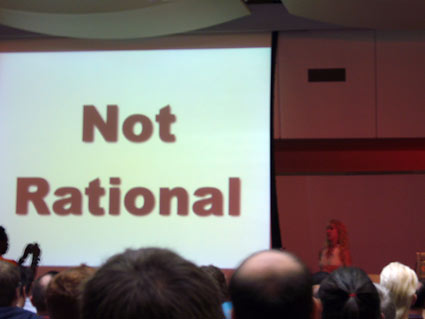Kathy Sierra standing infront of slide saying 'notrational'